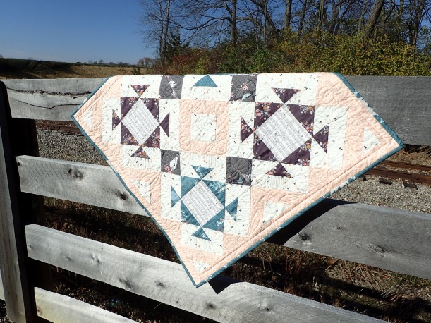quilt-on-fence-by-railroad
